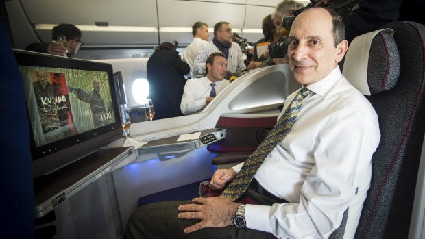 Qatar Airways CEO Akbar al Baker sits in the first Airbus A350 for Qatar Airways.