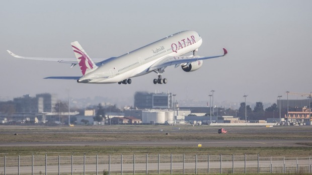 The Airbus A350 XWB takes off after the first delivery of the new passenger jet at Qatar Airways in Toulouse.
