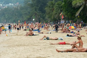 Foreign tourists relax at Patong beach in Phuket on Christmas Day.