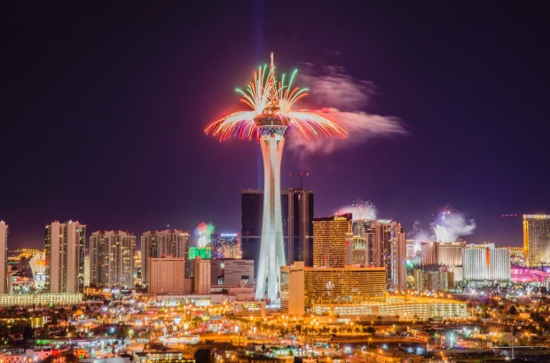 Fireworks explode from casinos along The Strip at midnight in Las Vegas.
