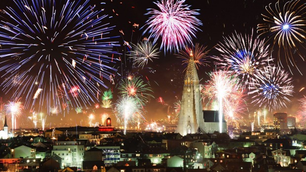 In Iceland's Reykjavik, you may be lucky enough to witness fireworks with the northern lights as a backdrop.