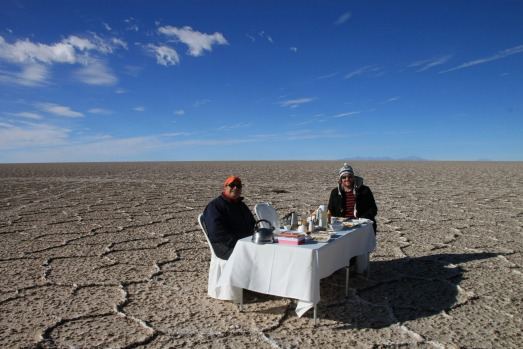 Eating in style: Lunch is served on a linen-covered table set up on the salt pan.