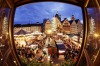 This photo, taken with a fisheye lens, shows people gathering at the traditional Christmas Market in Frankfurt, Germany. ...