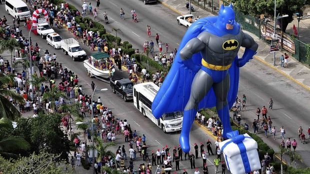 A balloon in the shape of comic hero Batman floats during a Christmas parade along the waterfront of the tourist resort ...