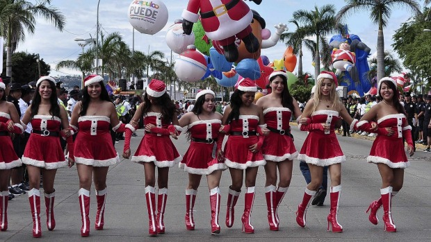 Women dressed as Santa Claus take part in a Christmas parade along the waterfront of the tourist resort of Acapulco, Mexico.