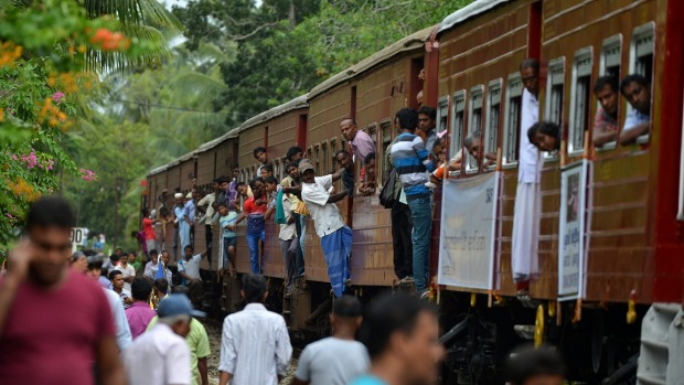 Sri Lankan passengers travel on the Ocean Queen Express, which was swept away during the 2004 tsunami and later ...