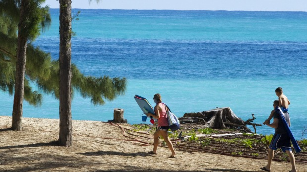 People walk toward the beach near where President Barack Obama and the first family are spending time at Bellows Air ...