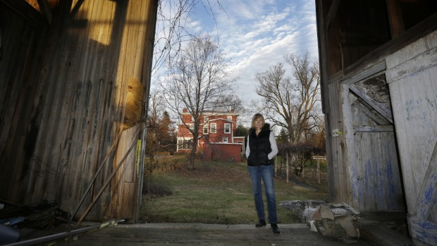 Owner Christine Cole, stands in a doorway of a barn at Highland Farm in Doylestown Township. Oscar Hammerstein co-wrote ...