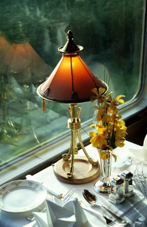 Lamp and table setting in dining car of the Eastern and Oriental Express Train.