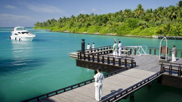 Guests arrive by luxurious launch at the One & Only Reethi Rah resort, Maldives.