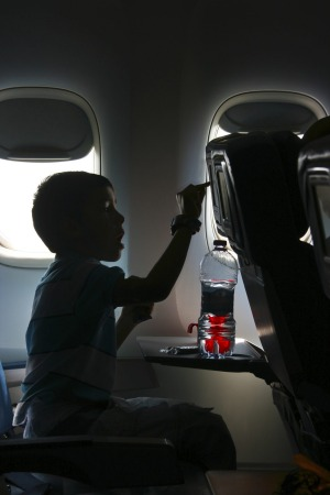 Mile high snub: Airlines are extremely cautious about what young passengers can watch.