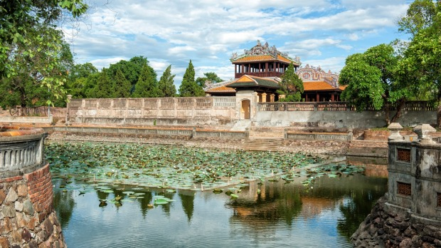 Moat of the Imperial Citadel of Hue, one of the many imposing palaces in the city.