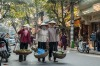 Local women stroll through the centre of Hanoi's Old Quarter.
