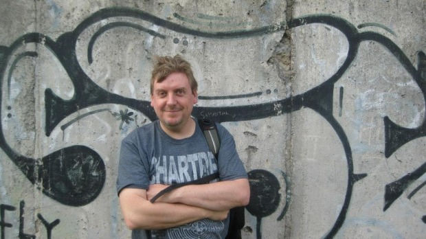 Jolyon Philcox, TripAdvisor's top contributor for 2014, in front of the Berlin Wall in Germany.