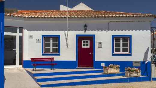 A house in the colours of the coast at Porto Covo.