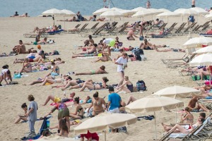 'Beaching' is a favourite pastime for tourists visiting the city: La Marbella beach in Barcelona.