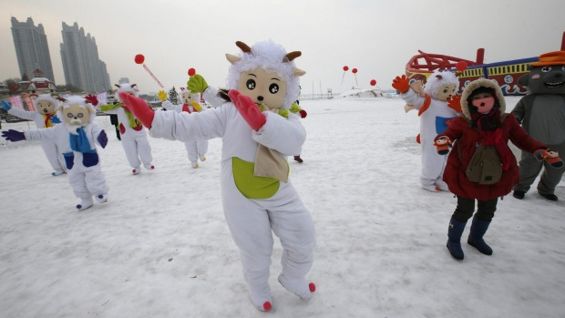 Dancers in costumes to celebrate commencement of the 16th Harbin International Ice and Snow Sculpture Festival. 2015 is ...