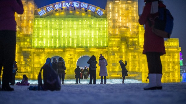 People visiting the China Ice and Snow World on the eve of the opening ceremony of the Harbin International Ice and Snow ...