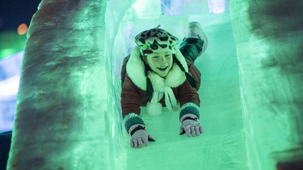 A girl rides a slide at the China Ice and Snow World on the eve of the opening ceremony of the Harbin International Ice ...