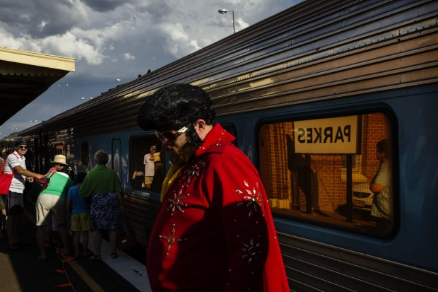 One of the hired town Elvis Impersonators on the Platform at Parkes after getting of the train from Central Station to ...