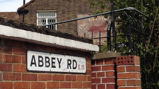 Abbey Road, West Ham, London, with The Greyhound pub in background.