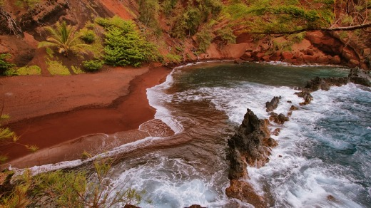 A red sand beach at Kaihalulu, east Maui, Hawaii Red.