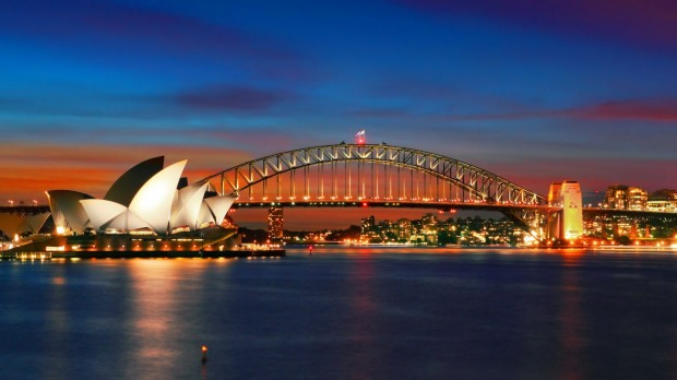 Iconic Sydney: the Sydney Opera House and Sydney Harbour Bridge at  sunset.