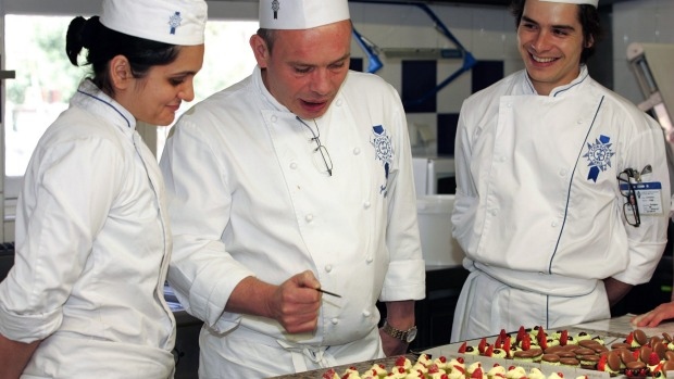 Icing on the cake: A chef tutors students in the finer points of presentation at Le Cordon Bleu International.