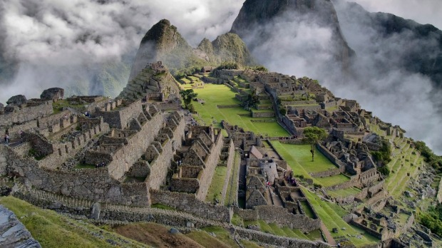 Machu Picchu, Peru: These Incan ruins, perched on an Andean mountaintop and surrounded by steep green slopes, rushing ...