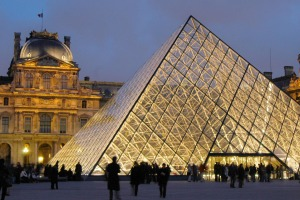 City hopping: Enjoy the sights of Paris including the  pyramid at the Louvre.