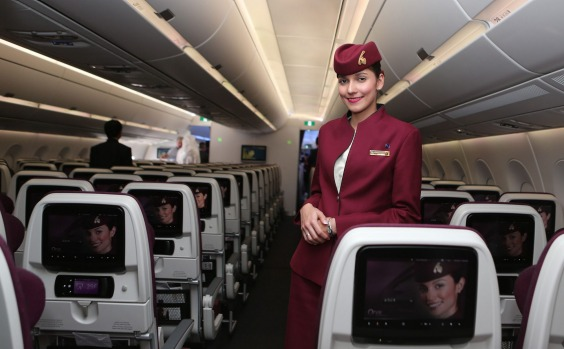A Qatar Airways flight attendant on board the new Airbus A350XWB at the Doha International Airport.