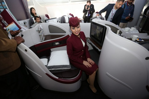 A Qatar Airways flight attendant poses for a photo on a new Airbus A350XWB at the Doha international airport. The ...