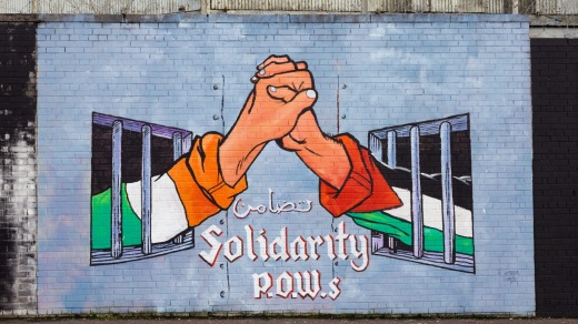 These walls can talk: A political mural in Belfast, Northern Ireland.