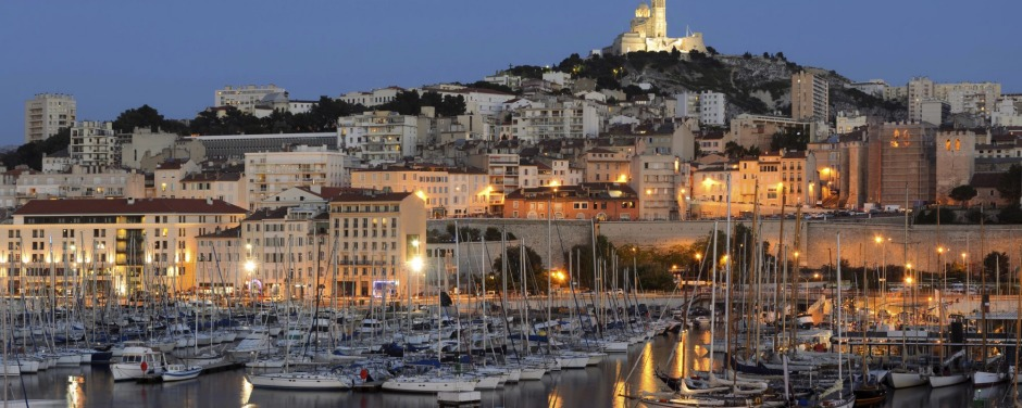 Marseille harbor with its famous Notre Dame church, France.