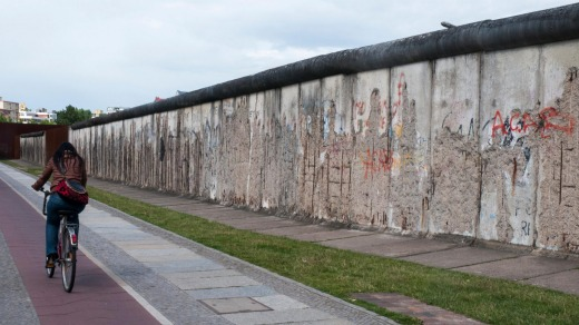 A cyclist passes the Berlin Wall memorial at Bernauer Strasse.