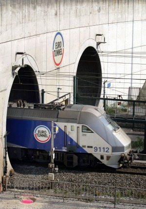THE LONGEST UNDERSEA TUNNEL IN THE WORLD: A train emerges from the Eurotunnel in Coquelles, northern France. Since the ...
