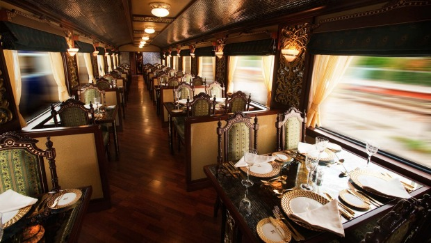 THE MOST EXPENSIVE TRAIN JOURNEY IN THE WORLD: The Peacock Restaurant on board the Maharajas' Express.