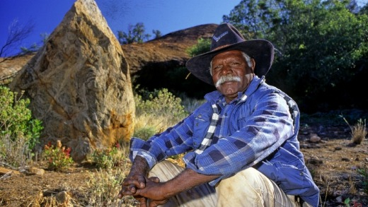 Local guide Stanley outside Cave Hill, one of the most significant rock art sites in Central Australia.