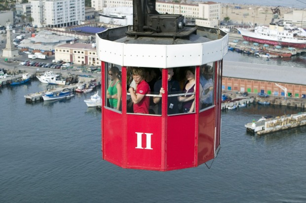 PORT CABLE CAR, BARCELONA, SPAIN:  Suspended high above the city's harbour, the tiny red and white boxes of the Port ...