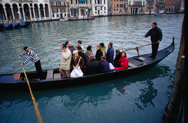 TRAGHETTO, VENICE, ITALY: Traghetti are the people's gondolas, operating from one side of the city's Grand Canal to the ...