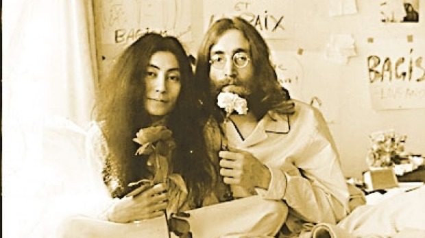 """John Lennon and Yoko  'giving peace a chance"""" in their bed-in."""