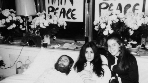 """John Lennon, with his wife Yoko Ono and Gail Renard during his 1969 """"bed-in"""" in Montreal."""