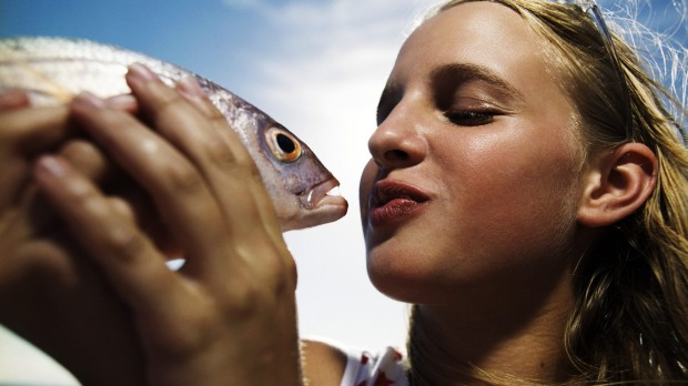 Puckering up to kiss the fish.