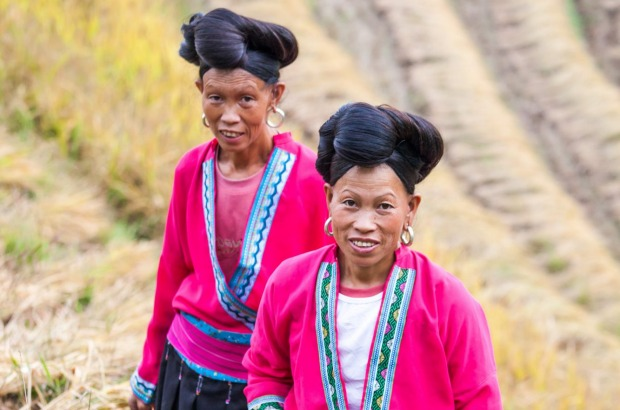 Two yao ethnic minority women on rice terrace Women from the Yao minority.