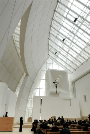 Jubilee Church: Created in 2003, the bright white church is covered with a curved shell of multiple travertine and ...