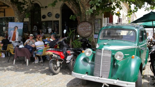 Colonia's quirky El Drugstore cafe, where vintage cars have been parked outside and remodelled into seating booths.