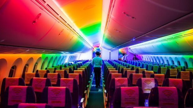 Attendees view the interior of a Boeing 787 Dreamliner aircraft operated by Scoot, a unit of Singapore Airlines, during ...