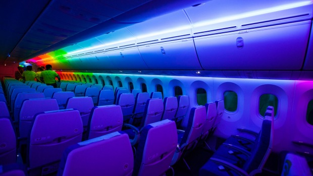 Attendees view the interior of the Dreamliner aircraft operated by Scoot.