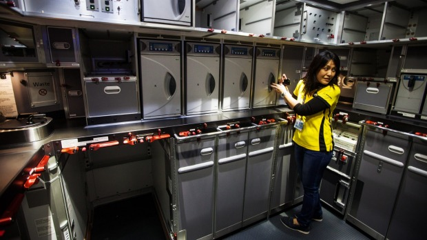An employee looks in the galley of a Boeing 787 Dreamliner aircraft operated by Scoot., a unit of Singapore Airlines ...