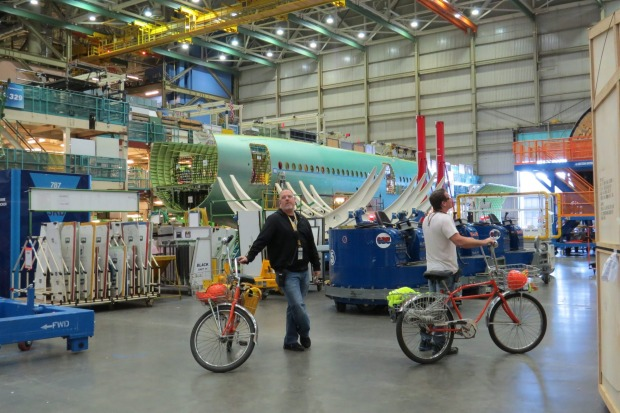 Boeing employees travel around the factory by bicycle.